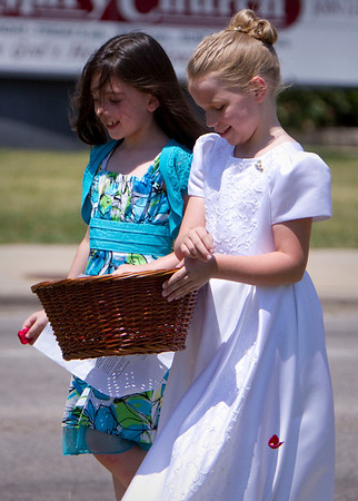 Gina Greenwald, left 8, and Grace Adams, 7, both from McHenry spread flower pedals during the St. Patrick's Church traditional Corpus Christi procession with the Blessed Sacrament in McHenry Sunday June 10, 2012.  John Konstantaras photo for the Northwest Herald