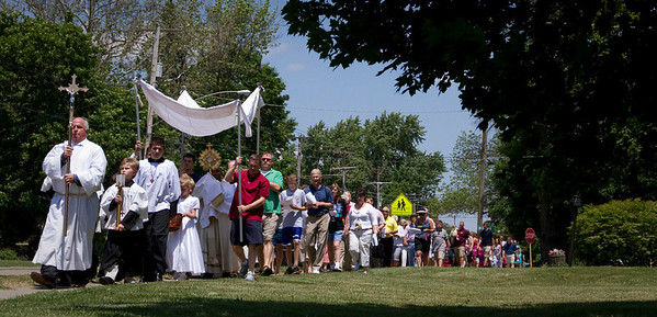 Over 100 people participate in the St. Patrick's Church traditional Corpus Christi procession on Route 31 in McHenry Sunday June 10, 2012.  John Konstantaras photo for the Northwest Herald