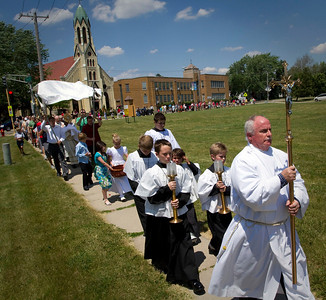 St. Patrick's Church Eucharist Minister Tim Madden leads the  traditional Corpus Christi procession on Pearl Street in McHenry Sunday June 10, 2012.  John Konstantaras photo for the Northwest Herald
