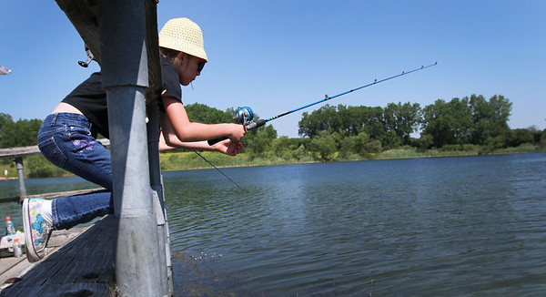 """Alaina, Ostergaard, 8 from Crystal Lake, fishes off the pier at Lake Atkins during the McHenry County Conservation District's """"Hooked on Fishing"""" family event on Lake Atkins at The Hollows in Cary Sunday June 10, 2012.  John Konstantaras photo for the Northwest Herald"""