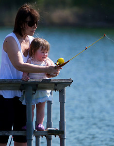 """Brenda Ceisel, from Crystal Lake, helps her one-year-old granddaughter Molly Telander, from Belvidere, during the McHenry County Conservation District's """"Hooked on Fishing"""" family event on Lake Atkins at The Hollows in Cary Sunday June 10, 2012.  John Konstantaras photo for the Northwest Herald"""
