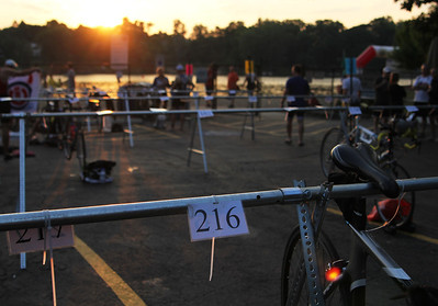 Sunday, June 10th, racers begin their preparation for the 6th annual Lake in the Hills triathlon. An estimated 300 racers began their day at Indian Trail Beach and crossed the finish line at Ken Carpenter Park.