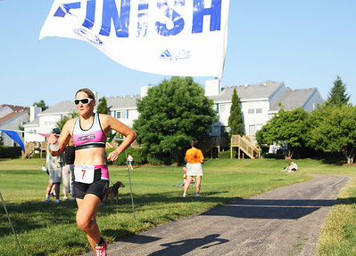 Female racer crosses the finish line of the 6th annual Lake in the Hill Triathlon on June 10, 2012. The racers ended their 20 mile race at Ken Carpenter Park in Lake in the Hills.