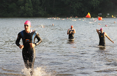 Racers exit the first section of the 6th annual Lake in the Hill Triathlon on Sunday, June 10th 2012. The race began at Indian Trail Beach and ended at Ken Carpenter Park.