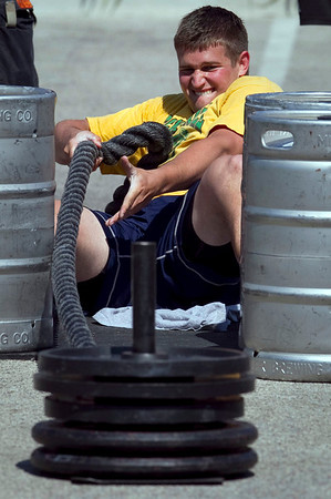 J.D. Barchard, from Crystal Lake competes in the arm over arm sled pull during the Strongman competition in the parking lot at Buffalo Wild Wings in Crystal Lake Sunday June 10, 2012.  John Konstantaras photo for the Northwest Herald