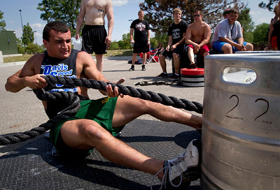 Joey Coriaci, 18 from Crystal Lake, in the arm over arm sled pull event during the Strongman competition in the parking lot at Buffalo Wild Wings in Crystal Lake Sunday June 10, 2012.  John Konstantaras photo for the Northwest Herald