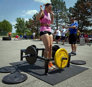 Samantha Nirvia, 18 from Cary, drops a sled of weights after completing the Frame Cary during the Strongman competition in the parking lot at Buffalo Wild Wings in Crystal Lake Sunday June 10, 2012.  John Konstantaras photo for the Northwest Herald