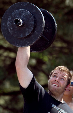 Mike Spagnola, owner of The Edge Strength and Conditioning in Cary, lifts a 100 pound weight during the Circus Dumbell event at the Strongman competition in the parking lot at Buffalo Wild Wings in Crystal Lake Sunday June 10, 2012.  John Konstantaras photo for the Northwest Herald