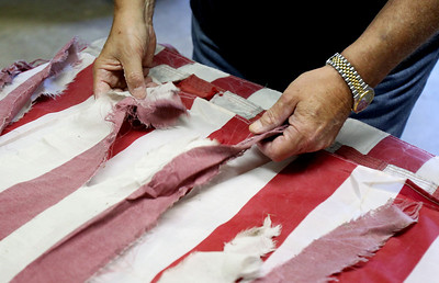 Sarah Nader - snader@shawmedia.com Senior Vice Commander of VFW Post 4600 Thomas McCormack of McHenry untangled a damaged American flags on while preparing for the VFW Post 4600 annual flag burning ceremony this Thursday. Last year the VFW properly disposed of over 400 flags.