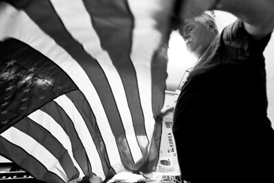 Sarah Nader - snader@shawmedia.com Senior Vice Commander of VFW Post 4600 Thomas McCormack of McHenry unfolds hundreds of old and damaged American flags on Tuesday, June 12, 2012 in preparation for the VFW Post 4600 annual flag burning ceremony this Thursday. Last year the VFW properly disposed of over 400 flags.