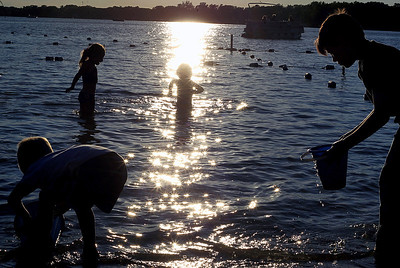 Sarah Nader - snader@shawmedia.com Kids enjoy Crystal Lake at dusk while swimming at Main Beach Park in Crystal Lake on Tuesday, June 12, 2012.