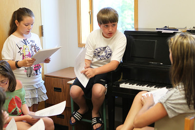 Mike Greene - mgreene@shawmedia.com Kyle Zetterlund, 13 of Cary, asks vocal director Leanne Dority a question about lyrics during Rock Jam Summer Camp Tuesday, June 12, 2012 at St. Barnabas Lutheran Church in Cary. The camp offers kids from 3rd-8th grade a chance to play music with others in a rock band environment and improve their music skills.