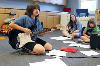 Mike Greene - mgreene@shawmedia.com Matthew Drozt, 12 of Prairie Grove, and other students listen for direction during Rock Jam Summer Camp Tuesday, June 12, 2012 at St. Barnabas Lutheran Church in Cary. The camp offers kids from 3rd-8th grade a chance to play music with others in a rock band environment and improve their music skills.