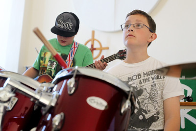 Mike Greene - mgreene@shawmedia.com Otto Skelley, 11 of Cary, waits for his cue while performing a song during Rock Jam Summer Camp Tuesday, June 12, 2012 at St. Barnabas Lutheran Church in Cary. The camp offers kids from 3rd-8th grade a chance to play music with others in a rock band environment and improve their music skills.