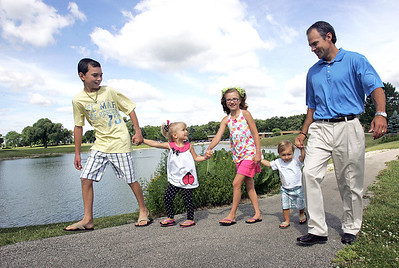 "H. Rick Bamman - hbamman@shawmedia.com Mark Molzer of McHenry walks with his children from left Alex, Anna, Ali Grace and Elliott on the campus of Advocate Good Shepherd Hospital in Barrington. Molzer, ""trains"" dads-to be"