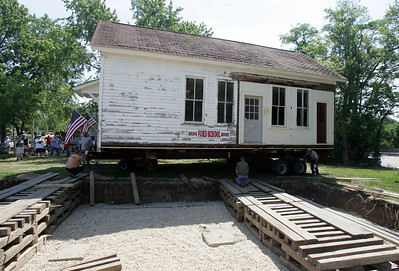 H. Rick Bamman - hbamman@shawmedia.com The 1836 building is positioned for placement on the new foundation.