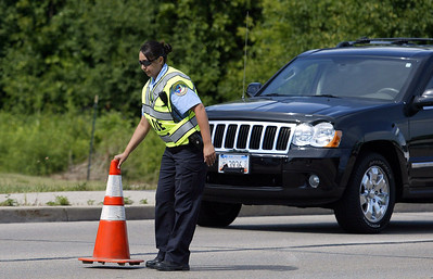 H. Rick Bamman - hbamman@shawmedia.com Lake in the Hills community service officer Olga Maldonado sets a traffic cone for traffic control along Algonquin Road.