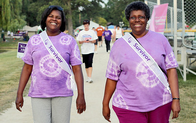 Sarah Nader - snader@shawmedia.com Cancer survivors Annette Berry (left) of Schaumburg and Rhonda Taylor of Hanover Park walk around the track while attending Relay for Life in Huntley on Friday, June 15, 2012. Relay for Life raises money for cancer research and cancer patients while helping spread cancer awareness, celebrate survivors and remember those who lost their lives to cancer.