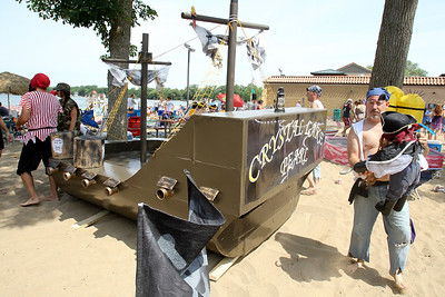 "Mike Greene - mgreene@shawmedia.com Wayne Alpert, of Crystal Lake, relocates ""Jack Sparrow"" on his teams boat titled ""Crystal Lake Pearl"" prior to the start of the 28th Annual America's Cardboard Cup Regatta Saturday, June 23, 2012 at Main Beach in Crystal Lake."
