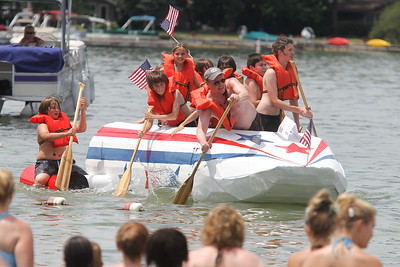 "Mike Greene - mgreene@shawmedia.com Team members paddle on ""Rocket America"" during the 28th Annual America's Cardboard Cup Regatta Saturday, June 23, 2012 at Main Beach in Crystal Lake."