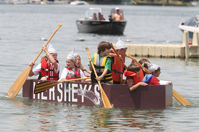 "Mike Greene - mgreene@shawmedia.com Crew members of the ""Hershey's"" boat paddle during the 28th Annual America's Cardboard Cup Regatta Saturday, June 23, 2012 at Main Beach in Crystal Lake."