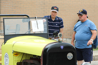 """Mike Greene - mgreene@shawmedia.com Ron Thomas (left), originally of Woodstock, speaks with Ed Quackenbush, of Lake Villa, about his mostly hand-built car during the 5th annual """"Remember Our Heroes"""" Car Show sponsored by VFW Post 5040 Saturday, June 23, 2012 in Woodstock. The annual event featured raffles from the post and the Ladies' Auxiliary with proceeds from the event benefiting VA Hospitals."""