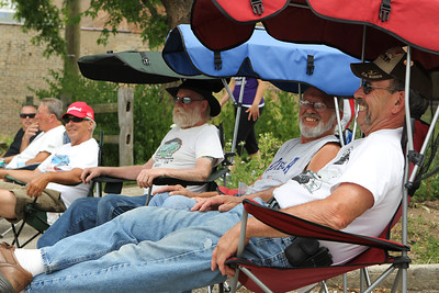 "Mike Greene - mgreene@shawmedia.com Ron Yori (right), of Crystal Lake, and other supporters of the VFW relax in chairs during the 5th annual ""Remember Our Heroes"" Car Show sponsored by VFW Post 5040 Saturday, June 23, 2012 in Woodstock. Proceeds from the event benefit VA Hospitals."