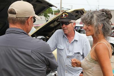 """Mike Greene - mgreene@shawmedia.com Lifetime VFW member Barry Mishler (center), of Union, speaks with Gary Bakley, of Huntley, and Carolyn DeFabio, of Grayslake, during the 5th annual """"Remember Our Heroes"""" Car Show sponsored by VFW Post 5040 Saturday, June 23, 2012 in Woodstock. The annual event featured raffles from the post including a M1 Garand rifle and M1911 pistol as well as raffles from the Ladies' Auxiliary that included skin care products and homemade afghans. Proceeds from the event benefit VA Hospitals."""