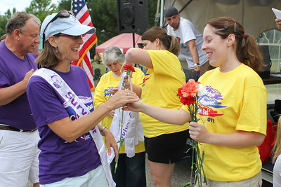 Mike Greene - mgreene@shawmedia.com Sheila Hansen, of Woodstock, receives a flower while being recognized as a cancer survivor during the 13th annual Relay for Life of North McHenry Saturday, June 23, 2012 at Albert A Adams Township Park in Johnsburg. This years' event raised over $50,000 in donations from 40 teams with over 300 participants.
