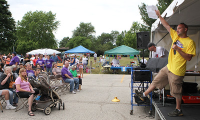 Mike Greene - mgreene@shawmedia.com Event chairman Jerry Schillaci pumps up the crowd at the start of the 13th annual Relay for Life of North McHenry Saturday, June 23, 2012 at Albert A Adams Township Park in Johnsburg. This years' event raised over $50,000 in donations from 40 teams with over 300 participants.