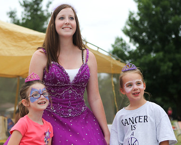"Mike Greene - mgreene@shawmedia.com Mackenzie Ruiz (left), 6 of McHenry, and Brooke Klowowicz, 7 of Johnsburg, pose for a photo with ""Princess"" Laura Laine, of Johnsburg, during the 13th annual Relay for Life of North McHenry Saturday, June 23, 2012 at Albert A Adams Township Park in Johnsburg. Laine's group raised money with the photos and helped the event to raise over $50,000 in donations from 40 teams with over 300 participants."