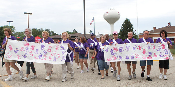 Mike Greene - mgreene@shawmedia.com Cancer survivors walk the first lap of the 13th annual Relay for Life of North McHenry Saturday, June 23, 2012 at Albert A Adams Township Park in Johnsburg. This years' event raised over $50,000 in donations from 40 teams with over 300 participants.