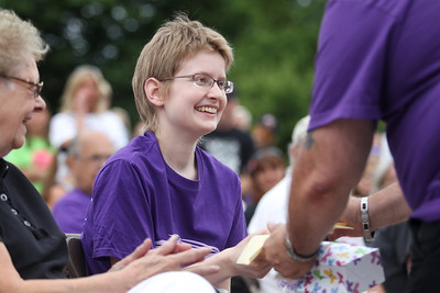 Mike Greene - mgreene@shawmedia.com Cancer survivor Jessica Bertulis, 16 of Johnsburg, receives a gift during the 13th annual Relay for Life of North McHenry Saturday, June 23, 2012 at Albert A Adams Township Park in Johnsburg. This years' event raised over $50,000 in donations from 40 teams with over 300 participants.