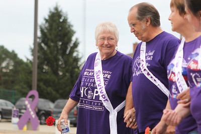 Mike Greene - mgreene@shawmedia.com Cancer survivor Diane Rasbaugh, of Spring Grove, smiles while holding hands with her husband Dave, also a cancer survivor, during the 13th annual Relay for Life of North McHenry Saturday, June 23, 2012 at Albert A Adams Township Park in Johnsburg. This years' event raised over $50,000 in donations from 40 teams with over 300 participants.