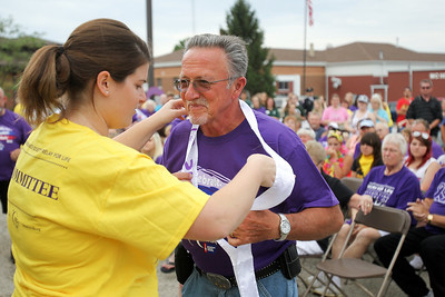 Mike Greene - mgreene@shawmedia.com Cancer survivors received sashes and purple shirts in honor of their battles at the 13th annual Relay for Life of North McHenry Saturday, June 23, 2012 at Albert A Adams Township Park in Johnsburg. This years' event raised over $50,000 in donations from 40 teams with over 300 participants.