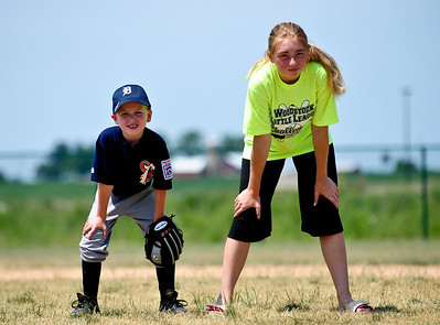 Josh Peckler - Jpeckler@shawmedia.com Mason Schalund, 6 of Wonder Lake (left) waits for a ball in the infield with buddy Joanna Watson of Woodstock, 12 at Merryman Fields Park Sunday, June 24, 2012 for the Woodstock Little League Challenger baseball Division. The Challenger Division allows boys and girls with physical and mental disabilities to enjoy the game of baseball.