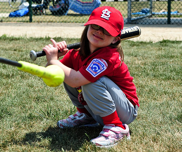 Josh Peckler - Jpeckler@shawmedia.com Katie Thomas, 6 of Bull Valley uses a unique style while warming up hitting at Merryman Fields Park Sunday, June 24, 2012 for the Woodstock Little League Challenger Baseball Division. The Challenger Division allows boys and girls with physical and mental disabilities to enjoy the game of baseball.