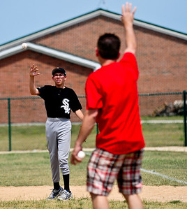 Josh Peckler - Jpeckler@shawmedia.com Jacob Kotecki, 14 of Crystal Lake throws a baseball back to a coach at Merryman Fields Park Sunday, June 24, 2012 for the Woodstock Little League Challenger Baseball Division. The Challenger Division allows boys and girls with physical and mental disabilities to enjoy the game of baseball.