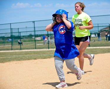 Josh Peckler - Jpeckler@shawmedia.com Nikki Durante, 12 of Woodstock (left) runs with buddy Emily Leclair of Wood Stock at Merryman Fields Park Sunday, June 24, 2012 for the Woodstock Little League Challenger Baseball Division. The Challenger Division allows boys and girls with physical and mental disabilities to enjoy the game of baseball.