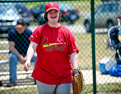 Josh Peckler - Jpeckler@shawmedia.com Alissa Weise, 20 of Crystal Lake lets out a big smile as she warms up playing catch at Merryman Fields Park Sunday, June 24, 2012 for the Woodstock Little League Challenger Baseball Division. The Challenger Division allows boys and girls with physical and mental disabilities to enjoy the game of baseball.