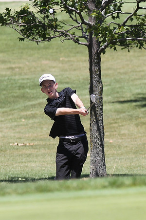Mike Greene - mgreene@shawmedia.com Adam Poole hits an approach shot during the McHenry County Junior Golf Association's Pinecrest Open Monday, June 25, 2012 at Pinecrest Golf Club in Huntley.