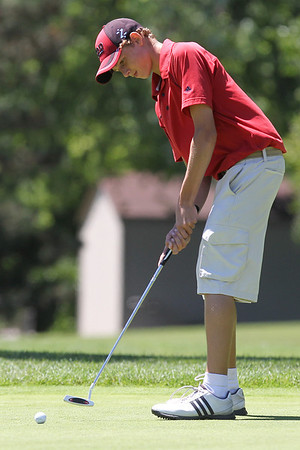 Mike Greene - mgreene@shawmedia.com Brad Spoeth putts on the green of the 8th hole during the McHenry County Junior Golf Association's Pinecrest Open Monday, June 25, 2012 at Pinecrest Golf Club in Huntley.