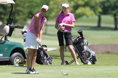 Mike Greene - mgreene@shawmedia.com Larisa Luloff prepares to tee off on the 1st hole during the McHenry County Junior Golf Association's Pinecrest Open Monday, June 25, 2012 at Pinecrest Golf Club in Huntley.