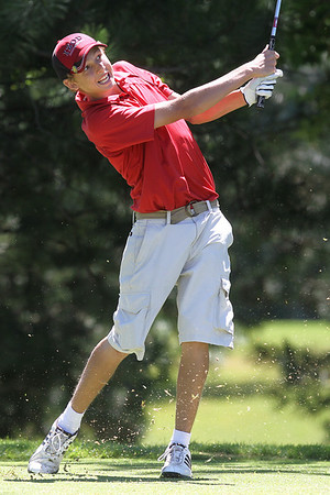 Mike Greene - mgreene@shawmedia.com Brad Spoeth tees off on the 8th hole during the McHenry County Junior Golf Association's Pinecrest Open Monday, June 25, 2012 at Pinecrest Golf Club in Huntley.