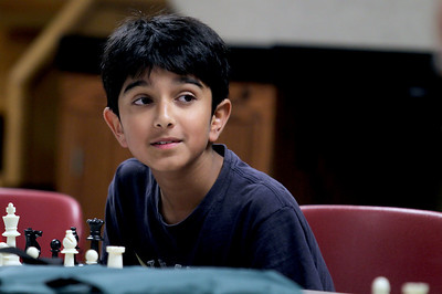 Sarah Nader - snader@shawmedia.com Aditya Khandeshi, 10, of Crystal Lake beat chess champion Bob Cairone of Crystal Lake during a chess tournament hosted by the Crystal Lake Public Library on Tuesday, June 26, 2012. Khandeshi was the first person in three years to beat Cairone during the tournament.