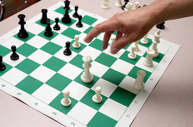 Sarah Nader - snader@shawmedia.com Bob Cairone of Crystal Lake makes his move while playing 17 consecutive games of chess during a tournament hosted by the Crystal Lake Public Library on Tuesday, June 26, 2012. The Crystal Lake Library hosted seven weeks of chess workshops to help learn strategy, positioning and logic before hosting the tournament against Cairone.