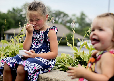 Sarah Nader - snader@shawmedia.com Brynn Harasimowicz (left), 4, of Crystal Lake and her sister, Grace, 2, enjoy an ice cream at The Freeze in Crystal Lake after spending the day at the beach on Thursday, June 28, 2012.