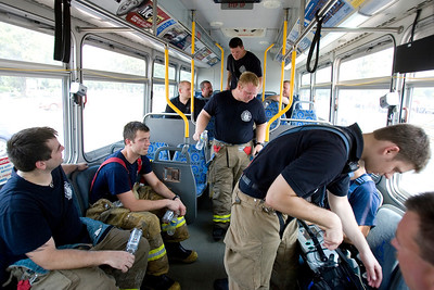 Mike Greene - mgreene@shawmedia.com Firefighters cool off in a Pace bus while fighting a fire at Community Thrift Store Thursday, June 28, 2012 in East Dundee. Local and regional fire crews teamed up to take turns dealing with the fire in the scorching heat.