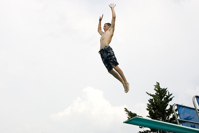 Mike Greene - mgreene@shawmedia.com Brian Tepper, 14 of Cary, jumps off the high dive at the Cary Public Pool Thursday, June 28, 2012 in Cary. Tepper was one of many who fought the heat Thurday by visiting local pools to cool off.
