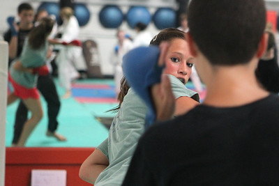 Mike Greene - mgreene@shawmedia.com Delaney Lebedum, 16 of Algonquin, trains for the upcoming AAU Karate National Championships Saturday, June 30, 2012 at Focus Martial Arts and Fitness in Lake in the Hills.